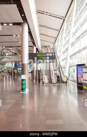 Dublin, Ireland - May 8th, 2018: The new Terminal 2 at Dublin Airport in Ireland. Passenger signage in the concourse. - Stock Photo