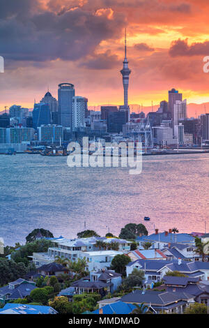 Auckland. Cityscape image of Auckland skyline, New Zealand during sunset with the Davenport in the foreground. - Stock Photo