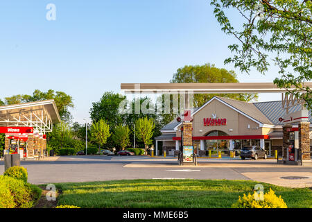 Lancaster, PA, USA - May 8, 2018: Fuel pumps at WaWa, a chain of fast food, gas, and convenience stores, which has over 750 locations. - Stock Photo