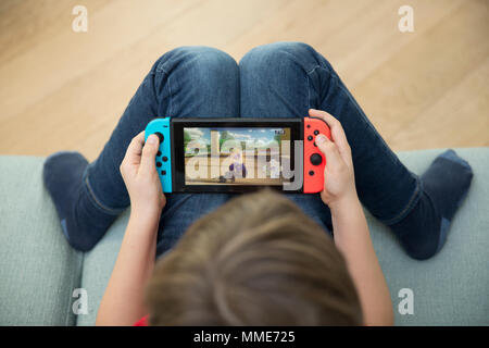 CHILD PLAYING VIDEO GAME - Stock Photo