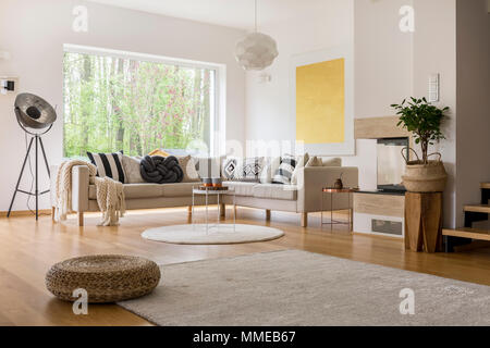 Big window with a view in cozy modern living room - Stock Photo