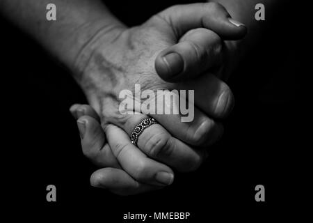 clasped hands, female - Stock Photo