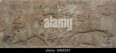 London. England. British Museum. King Ashurnasirpal II Hunting Lions. Stone wall panel relief, (865-860 BC) from the North-West Palace of Ashurnasirpa - Stock Photo