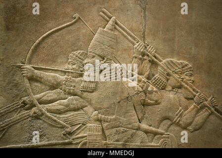 London. England. British Museum. King Ashurbanipal Hunting Lions. Stone wall panel relief, (645-635 BC) from the North Palace of (Room C, Panel 7-8),  - Stock Photo