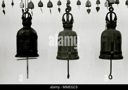 Temple bells at a Buddhist shrine at the Wat Saket Golden Mount Temple in Bangkok in Thailand in Southeast Asia Far East. Buddhism Religion Travel B&W - Stock Photo