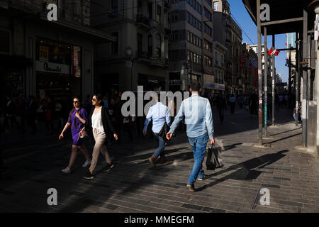 Istanbul, Turkey - April 19, 2018: Turkish people and  tourists are walking at The Istiklal Street, Beyoglu in a sunny springtime day. There are many - Stock Photo
