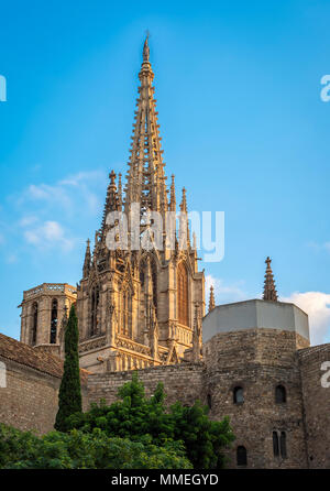 Barcelona, Spain - September 25, 2015: Spire of Cathedral of the Holy Cross and Saint Eulalia in Barcelona, Spain at sunset. Copy space in blue sky. - Stock Photo