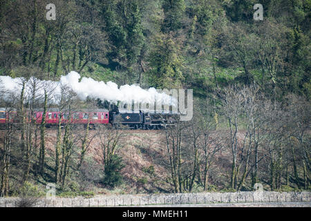 LMS Jubilee Class 5690 Leander steam locomotive runs along Silversands Bay - Stock Photo