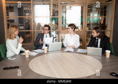 Business people discussing new design project at executive team  - Stock Photo