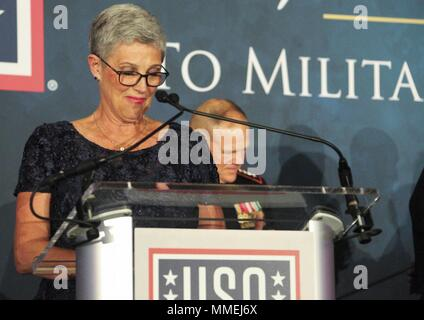 D'Arcy Neller, wife of Commandant of the Marine Corps Gen. Robert B. Neller, speaks to military members and guests during the 36th Annual USO Military Spouse Program Awards Dinner in Washington, D.C. May 10, 2018, May 10, 2018. The annual awards dinner honors military spouses. (U.S. Marine Corps photo by Sgt. Olivia G. Ortiz). () - Stock Photo