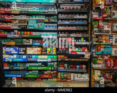 A wall of tobacco products in a convenience store in New York on Sunday, April 29, 2018. (© Richard B. Levine) - Stock Photo