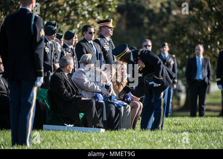 U.S. Army Chaplain, Willie Mashack (Maj.) offers condolences to the family of U.S. Army Staff Sgt. Bryan Black during Black's graveside service in Section 60 of Arlington National Cemetery, Arlington, Virginia, Oct. 30, 2017.  Black, a native of Puyallup, Washington, was assigned to Company A, 2nd Battalion,3rd Special Forces Group (Airborne) on Fort Bragg, North Carolina when he died from wounds sustained during enemy contact in the country of Niger in West Africa, Oct. 4, 2017.  (U.S. Army photo by Elizabeth Fraser / Arlington National Cemetery / released) - Stock Photo