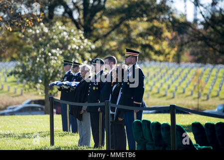 (From the left): Hollyanne Milley; Gen. Mark Milley, chief of staff, U.S. Army; Ryan McCarthy, acting secretary, U.S. Army; Karen Durham-Aguilera, executive director, Army National Military Cemeteries; and Col. Jerry Farnsworth, chief of staff, Arlington National Cemetery and Army National Military Cemeteries; attend the graveside service for U.S. Army Staff Sgt. Bryan Black in Section 60 of Arlington National Cemetery, Arlington, Virginia, Oct. 30, 2017.  Black, a native of Puyallup, Washington, was assigned to Company A, 2nd Battalion,3rd Special Forces Group (Airborne) on Fort Bragg, North - Stock Photo