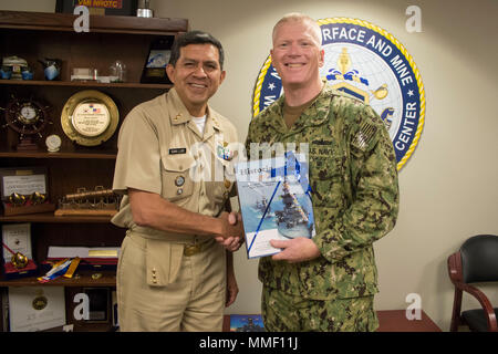 SAN DIEGO (Oct. 31, 2017) Commander, Naval Surface and Mine Warfighting Development Center (SMWDC), Rear Adm. John Wade (right), poses for a photo with Capt. Angel San Luis with the Mexican Naval Secretariat at Naval Base San Diego. Representatives of the Mexican Navy visited SMWDC to discuss surface warfare tactical development.  SMWDC is one of the Navy's five Warfighting Development Centers and its mission is to increase the lethality and tactical proficiency of the Surface Force across all domains.  (U.S. Navy photo by Christopher E. Tucker/Released) - Stock Photo