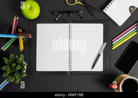 Workspace with book, pen and multiple office supplies. Top View. - Stock Photo