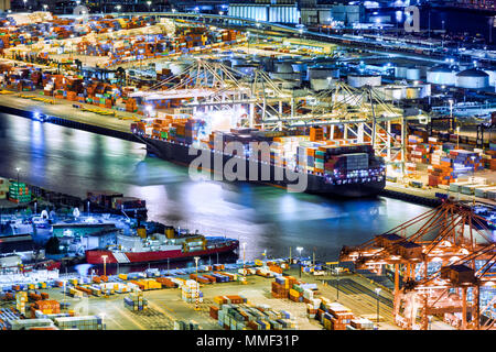 Aerial view of a cargo ship loaded in the Seattle harbor container terminal - Stock Photo