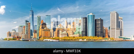 Downtown New York skyline panorama viewed from a boat sailing the Upper Bay - Stock Photo