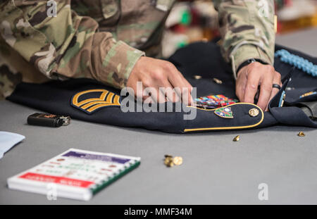 Great care is taken when assembling the dress uniforms of fallen service members at the Charles C. Carson Center, located at Dover Air Force Base in Dover, Del. The Charles C. Carson Center is home to the Port Mortuary which is responsible for returning all Department of Defense service members, civillians, and contractors who perish during contigency operations overseas. The 73,000 square foot facility was built in 2003 at a cost of $30 million. (U.S. Army photo by Master Sgt. Brian Hamilton/ released) - Stock Photo