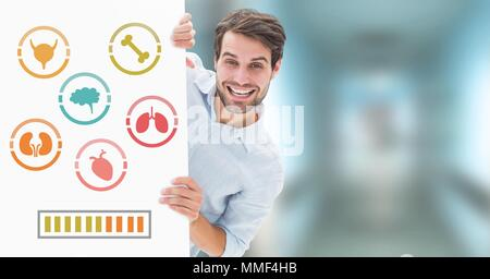 Human Body organs icons and man holding card - Stock Photo