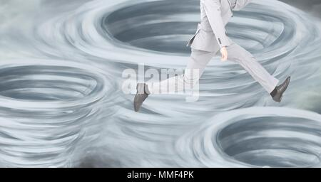 Tornado twisters painted and dark sky with man jumping with legs - Stock Photo