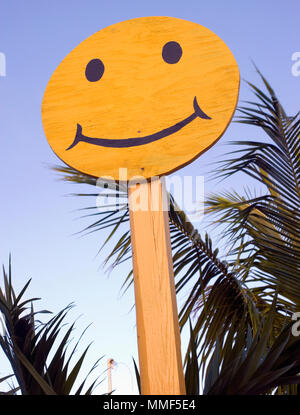 Plywood happy face sign with palm trees in the Bahamas - Stock Photo