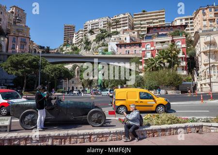 Monaco city center, tourists taking photo at bronze monument of William Grover (WILLIAMS) in his Bugatti 35B, winner of the first Monte Carlo Grand Pr - Stock Photo