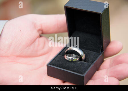 Best Man holding Wedding rings in box - Stock Photo