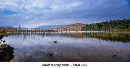 Panoramic view of lake against cloudy sky. - Stock Photo