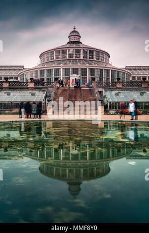 COPENHAGEN, DENMARK - APRIL 28, 2018. Botanical gardens building reflecting in pond water. - Stock Photo