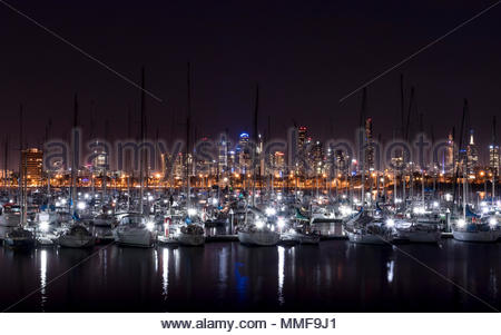 Melbourne skyline at night from Saint Kilda pier, looking over Royal Melbourne yacht club vessels. - Stock Photo