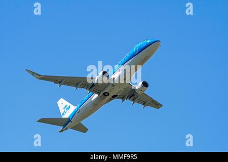 KLM Cityhopper Embraer 175, medium-range twin-engine jet airliner in flight