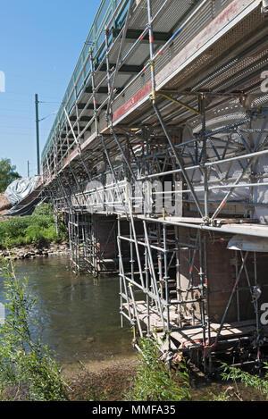 renovation of an old railway bridge over the river nidda in frankfurt am main, germany - Stock Photo