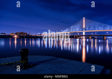 Night view of the Veterans' Glass City Skyway bridge in Toledo Ohio.  The bridges center pylon is lit up with LED lighting. - Stock Photo