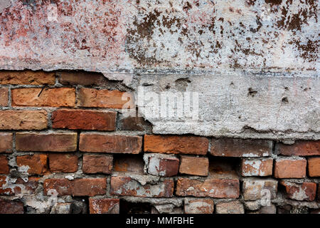 Photo of a colorful old decaying brick wall with peeling paint and stucco. Great for a background image or a texture. - Stock Photo