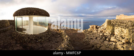 MIRADOR DEL RIO, LANZAROTE, CANARY ISLANDS, SPAIN, EUROPE: Panoramic view of  viewpoint designed by Cesar Manrique, with a young woman looking from th - Stock Photo