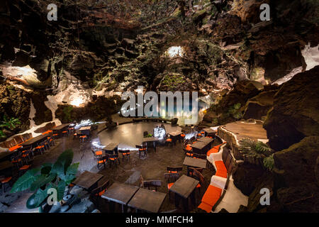 LOS JAMEOS DEL AGUA LANZAROTE, CANARY ISLANDS, SPAIN: The spectacular lava caves designed by Cesar Manrique at night. - Stock Photo