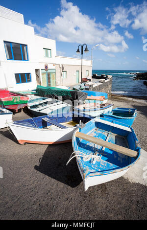 PUNTA MUJERES, LANZAROTE, CANARY ISLANDS, SPAIN, EUROPE: Fishing boats lying on dry land in the little village. - Stock Photo