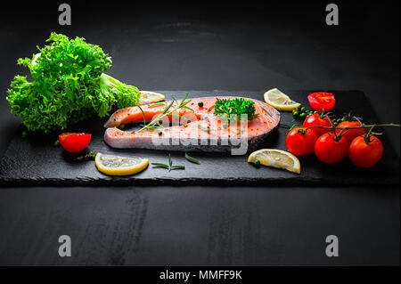 Fresh raw salmon steak with ingredient prepared for cooking - Stock Photo