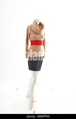 Elegant outfit with mini skirt spring wear on mannequin full body shop display. Woman fashion styles, clothes on white studio background. - Stock Photo