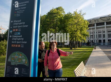 Moscow, Russia. 11th May, 2018. MOSCOW, RUSSIA - MAY 11, 2018: People near Luzhniki Stadium, a venue of the 2018 FIFA World Cup in Russia. Sergei Bobylev/TASS Credit: ITAR-TASS News Agency/Alamy Live News - Stock Photo