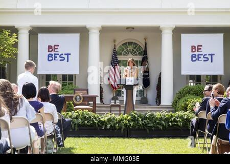 WASHINGTON, DC - WEEK OF MAY 07: First Lady Melania Trump recognizes Christian Bucks, a student form York, Pennsylvania, at her Be Best policy initiative rollout in the Rose Garden at the White House, Monday, May 7, 2018, in Washington, D.C. Bucks was congratulated for his development of the 'Buddy Bench' which helped address loneliness and assist fellow students build new friendships in his elementary school.  People:  First Lady Melania Trump - Stock Photo