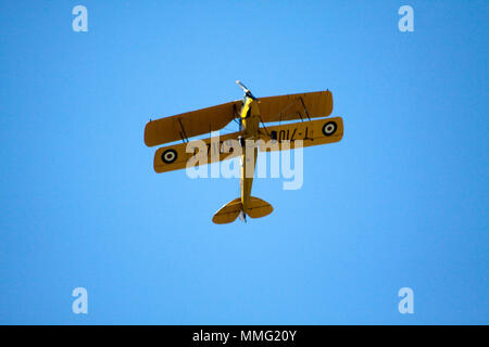 Tiger Moth flying over Hook Norton Oxfordshire - Stock Photo
