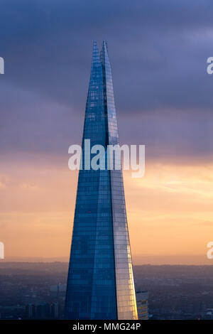 The Shard skyscraper at sunset, viewed from the Sky Garden.  Designed by Renzo Piano and inaugurated on 5 July 2012, - Stock Photo