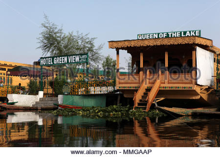 Houseboats lining Kashmir's famous Dal Lake are in fact luxurious floating hotels. Houseboats were first built in the 19th century to circumvent a law - Stock Photo