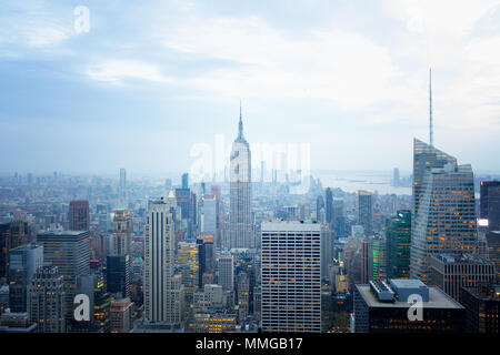The Empire State Building and New York skyline in the late afternoon  seen from the Top of the Rock, New York city United States of America - Stock Photo