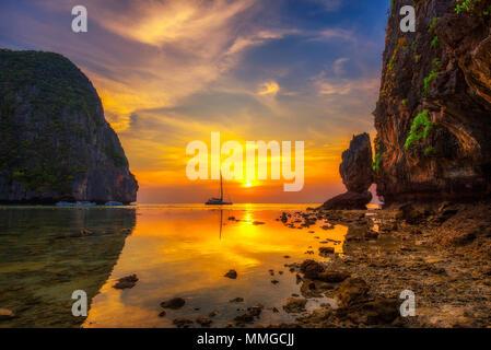 Sunset at the Maya beach on Koh Phi Phi island in Thailand - Stock Photo