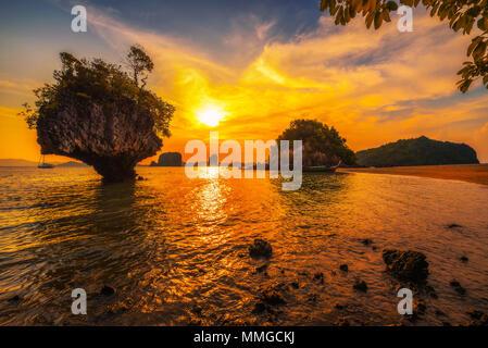 Sunset over Laopilae archipelago around Ko Hong island in Thailand - Stock Photo