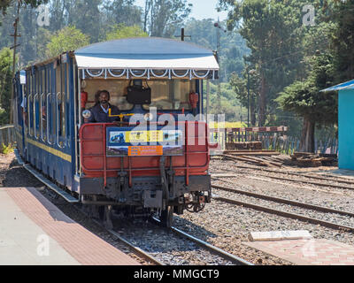 Ooty, India - March 4, 2018: Train arriving on the Nilgiri Mountain Railway from Coonoor - Stock Photo