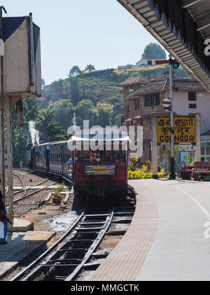 Coonoor, India - March 5, 2018: Steam train arriving from Mettupalayam on the Nilgiris Mountain Railway in Tamil Nadu - Stock Photo