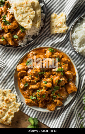 Homemade Indian Butter Chicken with Rice and Naan Bread - Stock Photo